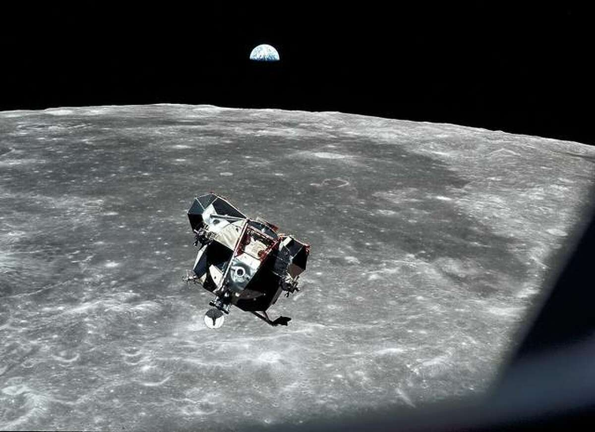 The Apollo 11 lunar module ascent stage, carrying astronauts Neil Armstrong and Buzz Aldrin, approaches the command and service modules for docking in lunar orbit. Astronaut Michael Collins remained with the command and service modules in lunar orbit while the other two crewmen explored the moon's surface. In the background the Earth rises above the lunar horizon.