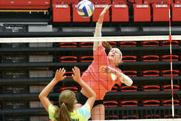 The Edwardsville Tigers and Father McGivney Griffins participated in a team camp at SIUE on Friday inside the Vadalabene Center. Teams played in two separate two-match round robins before bracket play concluded the day in the afternoon. The Tigers will be at Lafayette High School on Saturday.