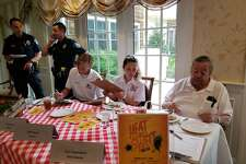 RDarien High School students and Darien EMS-Post 53 volunteers Bell Nieve, 16, and George Crull, 17, judged the competition, along with Gus Capadona, president of Atria's resident council and a resident himself.