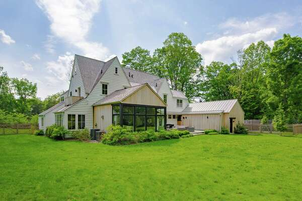 This house sits in a private setting, a level lot of just over two acres in the Greenfield Hill section of Fairfield, near the Westport border.