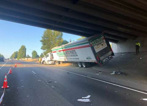 SB lanes of I-405 closed in Renton after box truck/tractor