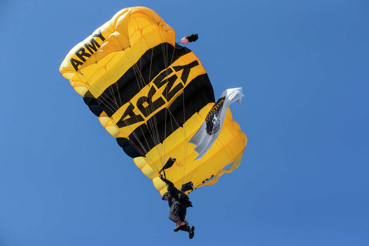 The U.S. Army parachute team the Golden Knights brings a commemorative Apollo flag as they parachute in to open the 50th anniversary celebration of the Apollo 11 moon landing at Space Center Houston on Saturday, July 20, 2019, in Houston.