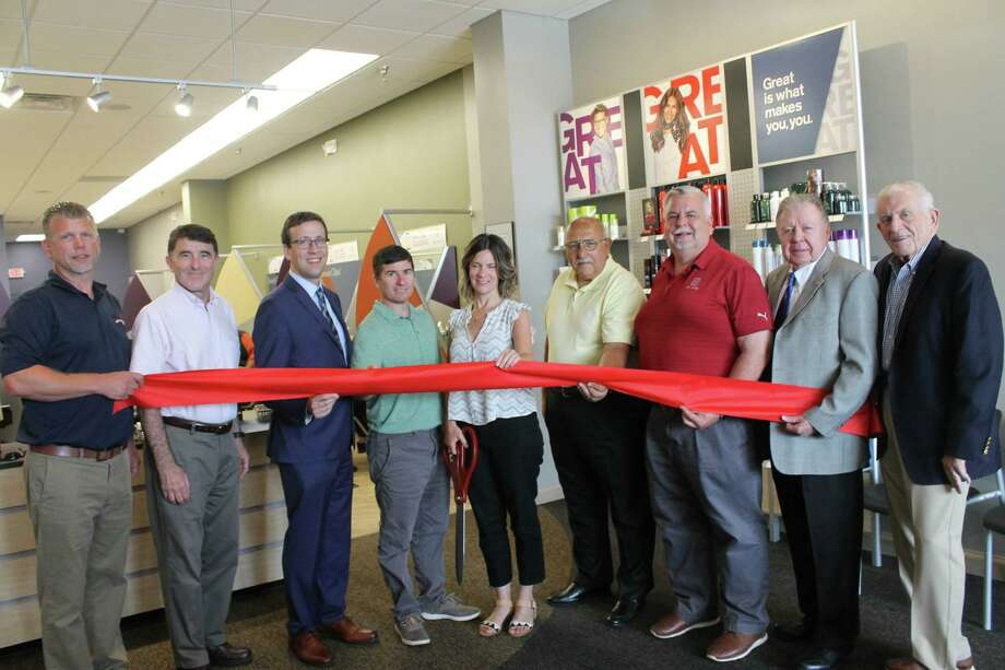 A grand opening for Great Clips in the Cromwell Square Shopping Center was held Thursday. From left are Middlesex County Chamber of Commerce Cromwell Division Chairman Rodney Bitgood, Director of Planning and Development Stuart Popper, state Sen. Matt Lesser, owners Ken and Laura Jarvis, Town Manager Tony Salvatore, Chamber Chairman Don Devivo, Immediate Past Chairman Jay Polke and President Larry McHugh Photo: Contributed Photo