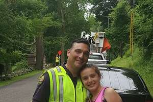 Ava Lombardo, of Newtown, with her dad, Lt. Robert Lombardo of the Greenwich Police Department. Ava will host a lemonade stand in Greenwich on Saturday to benefit the Catherine Violet Hubbard Animal Sanctuary in Newtown.