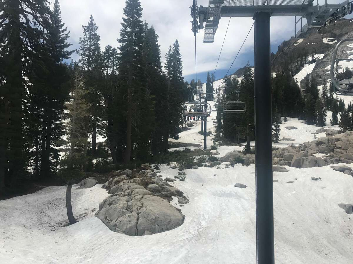 Skiers at Squaw Valley Alpine Meadows resorttake advantage of the last day of skiing, as the resort shut down for the 2018-2019 ski season on July 7, 2019.