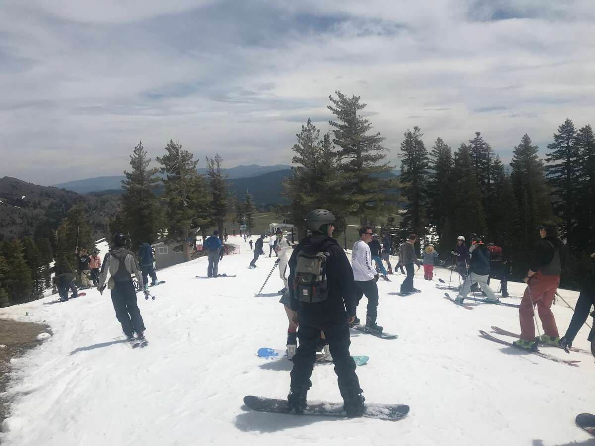 Skiers at Squaw Valley Alpine Meadows resort take advantage of the last day of skiing, as the resort shut down for the 2018-2019 ski season on July 7, 2019.