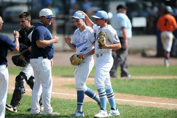 Stamford pitcher Grant Purpura celebrates with coaches and teammates at the end of the second inning against Orange in the American Legion state tournament opener at Cubeta Stadium on Saturday in Stamford. Stamford defeated Orange 6-0.