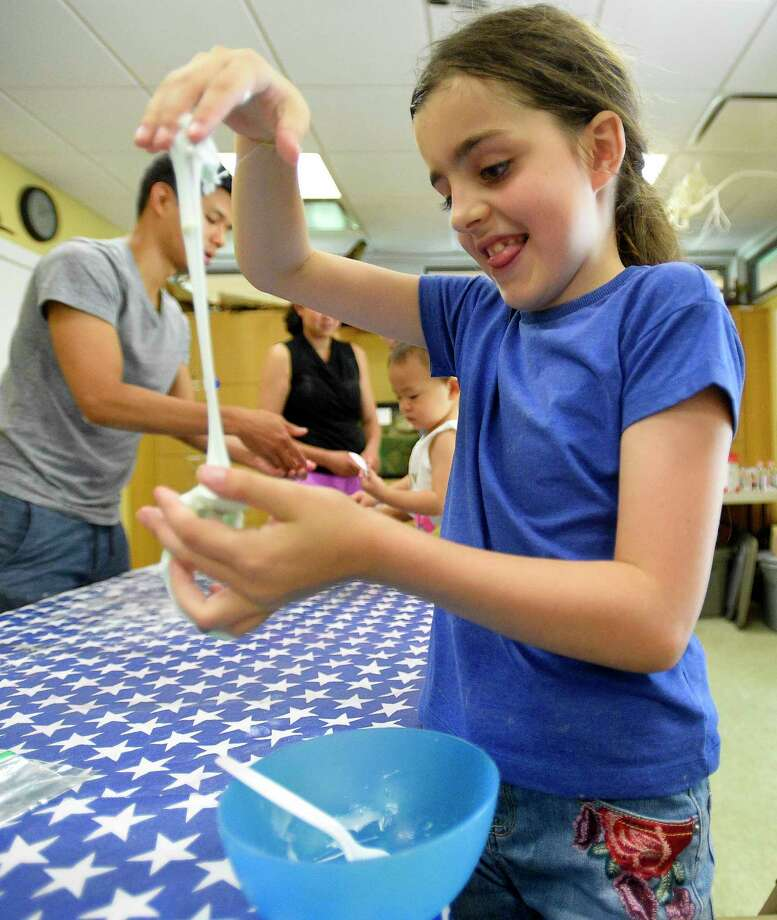 Alisa Kolokolchykova play with Galatic Slime she created during Moon Festival at the Stamford Museum and Nature Center on July 20, 2019 in Stamford, Connecticut. Guests help celebrate the 50th anniversary of the moon landing, learning about the phases of the moon, making a moon journal, discovering common constellations that can be found in the summer sky, making moon sand and galactic slime, viewing our asteroid and other space-themed items from our collection. Photo: Matthew Brown / Hearst Connecticut Media / Stamford Advocate