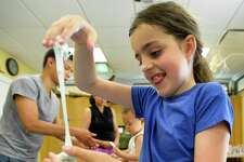 Alisa Kolokolchykova play with Galatic Slime she created during Moon Festival at the Stamford Museum and Nature Center on July 20, 2019 in Stamford, Connecticut. Guests help celebrate the 50th anniversary of the moon landing, learning about the phases of the moon, making a moon journal, discovering common constellations that can be found in the summer sky, making moon sand and galactic slime, viewing our asteroid and other space-themed items from our collection.