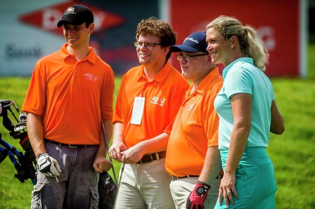 Suzann Pettersen, right, poses for a photo with, from left, Justin Doran, Nick Wagenmaker and Nick McCabe during the Special Olympics 3-Hole Challenge on Friday, July 19, 2019 during the inaugural Dow Great Lakes Bay Invitational at Midland Country Club. (Katy Kildee/kkildee@mdn.net)