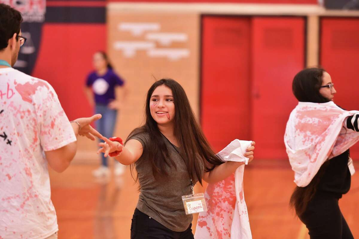 """Kayla Rodriguez participates in zombie tag during """"Zombie Camp."""""""