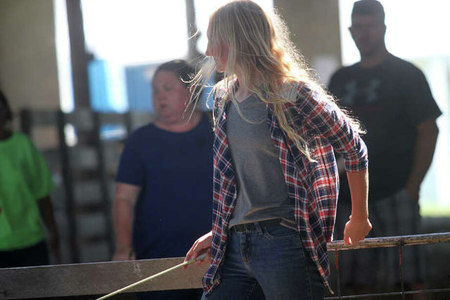 On the last day of the Cass County Fair, the 4-H livestock sale marked the culmination of hard work by many area 4-Hers. Photo: Rosalind Essig | Journal-Courier