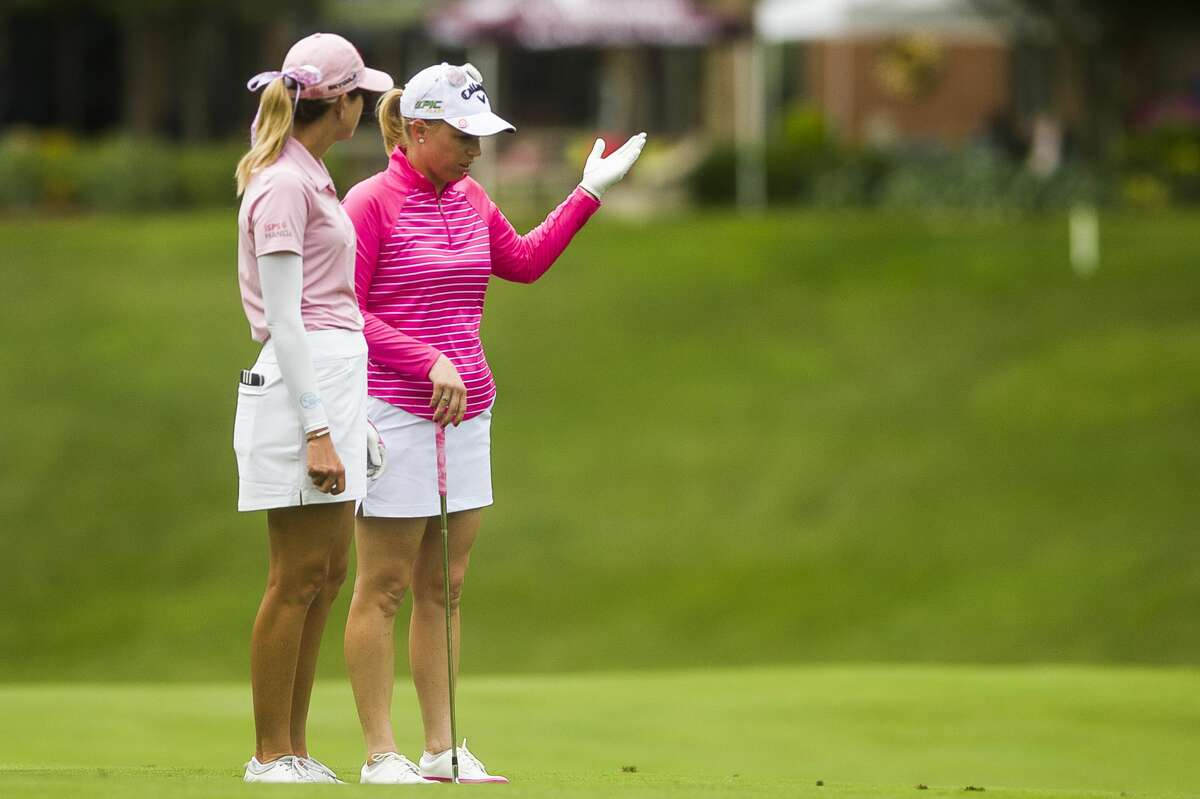 Partners Morgan Pressel of Florida and Paula Creamer of California chat during the fourth and final round of the Dow Great Lakes Bay Invitational on Saturday, July 20, 2019 at Midland Country Club. (Katy Kildee/kkildee@mdn.net)
