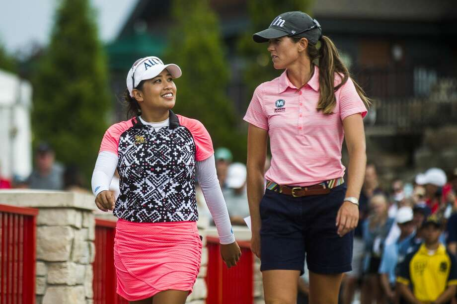 Jasmine Suwannapura of Thailand, left, and her playing partner Cydney Clanton of Alabama, right, celebrate after winning the Dow Great Lakes Bay Invitational on Saturday, July 20, 2019 at Midland Country Club. (Katy Kildee/kkildee@mdn.net) Photo: (Katy Kildee/kkildee@mdn.net)