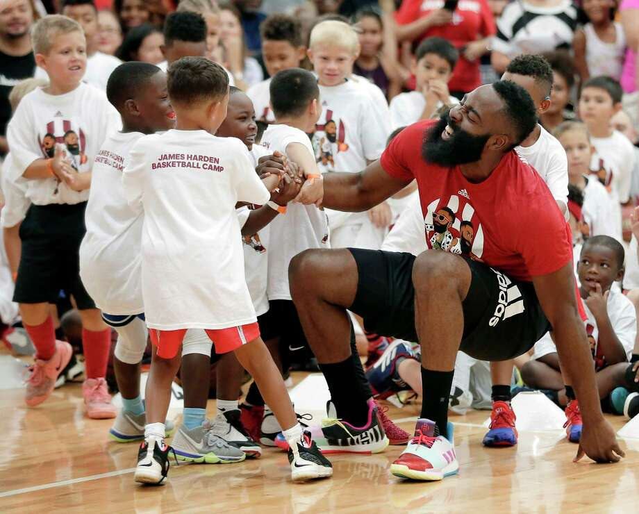 Houston Rockets' James Harden feigns an injury as he is helped up from the court after a fall by kids during a 20 second one-on-one game at the James Harden Basketball Camp held at the MI3 Center Saturday, Jul. 20, 2019 in Houston, TX. Photo: Michael Wyke, Contributor / © 2019 Houston Chronicle