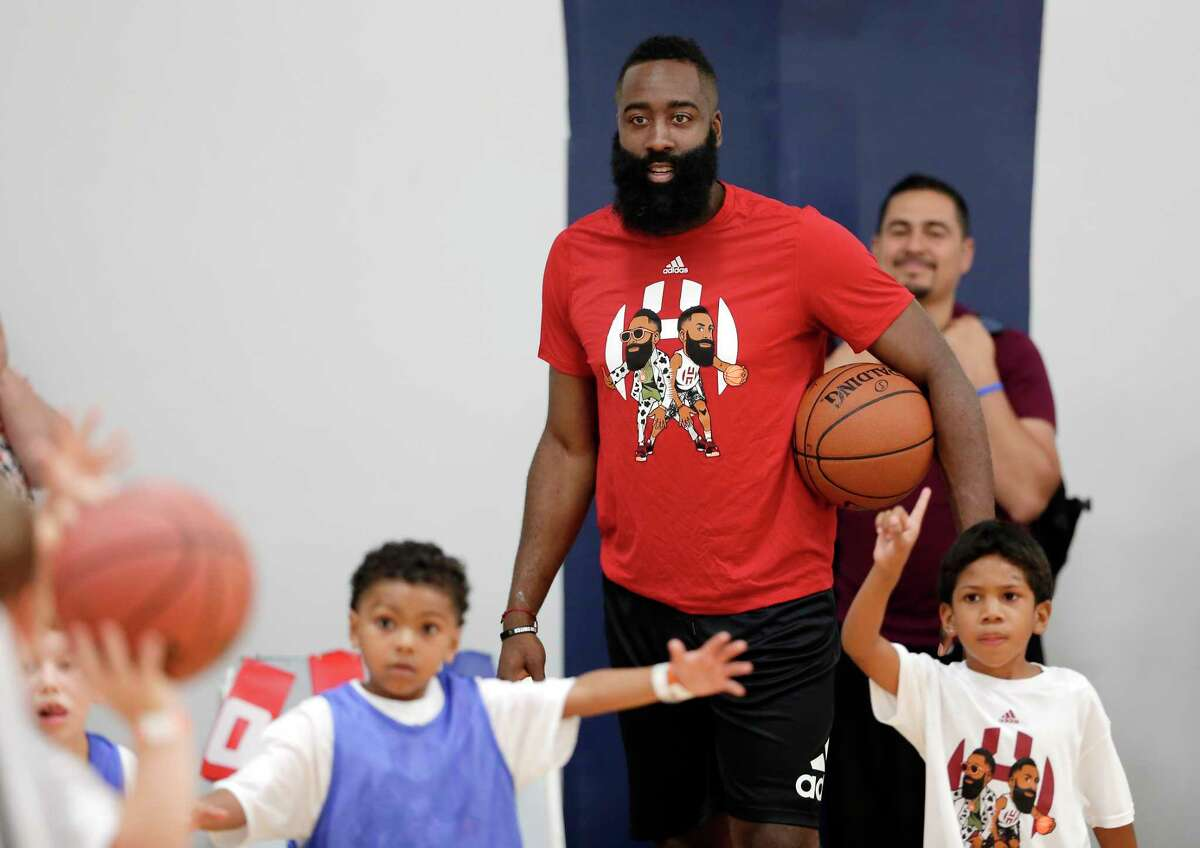 Houston Rockets' James Harden watches games being played by kids at the James Harden Basketball Camp held at the MI3 Center Saturday, Jul. 20, 2019 in Houston, TX.