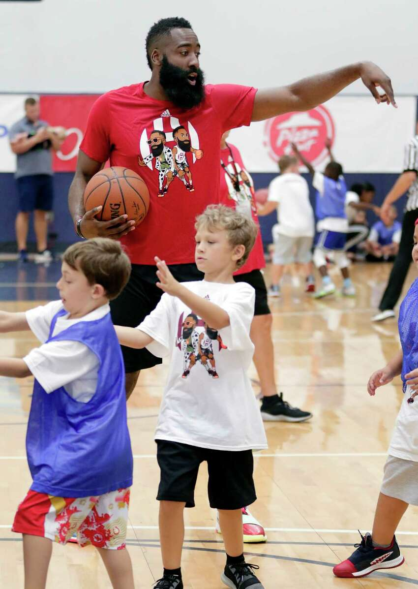 Houston Rockets' James Harden gives pointers as he watches one of the 12 basketball games being played by kids at the James Harden Basketball Camp held at the MI3 Center Saturday, Jul. 20, 2019 in Houston, TX.