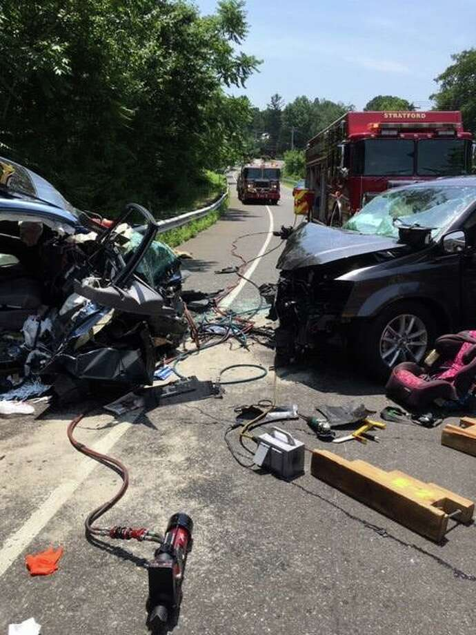 Officials responded to the scene of a collision between two minivans Saturday where they found 13 people injured, between six and eight of whom were children. Photo: Courtesy Of The Stratford Police Department