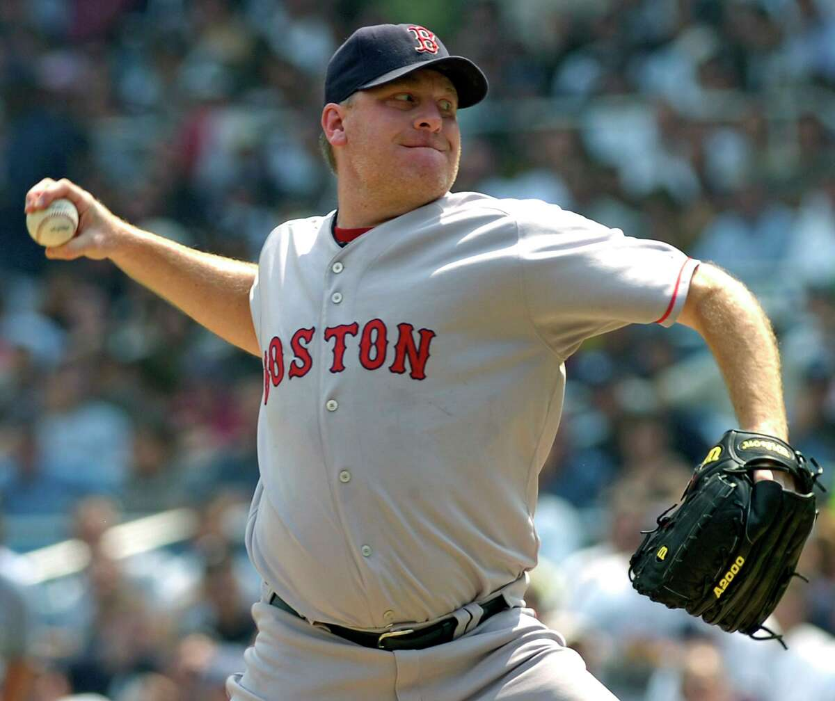 Red Sox pitcher Curt Schilling delivers against the Yankees in an August 2007 game.