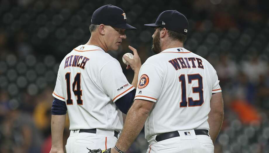 PHOTOS: 2019 Astros game-by-game  Houston Astros manager AJ Hinch (14) takes the ball from Houston Astros relif pitcher Tyler White (13) after two outs during the top ninth inning of the MLB game against the Pittsburgh Pirates at Minute Maid Park on Wednesday, June 26, 2019, in Houston. >>>See how the Astros have fared in each game this season ...  Photo: Yi-Chin Lee/Staff Photographer
