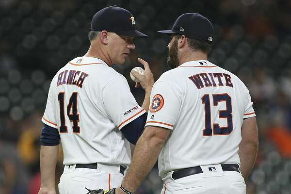 Houston Astros manager AJ Hinch (14) takes the ball from Houston Astros relif pitcher Tyler White (13) after two outs during the top ninth inning of the MLB game against the Pittsburgh Pirates at Minute Maid Park on Wednesday, June 26, 2019, in Houston.