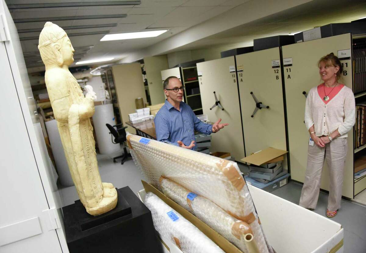 Collections Manager Timothy Walsh and Registrar Kirsten Reinhardt show items that are ready to be packed and stored, including a Tang Dynasty bodhisattva statue, as renovations continue at the Bruce Museum in Greenwich, Conn. Thursday, July 11, 2019. The Bruce is undergoing an expansion and renovation that will more than double its size, add improved exhibition, education, and community spaces and greatly expand its space for permanent and changing installations.