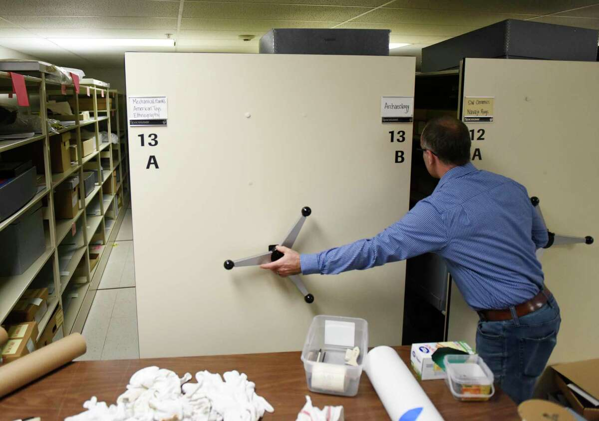 Collections Manager Timothy Walsh shows emptied storage shelves as staff prepare for construction at the Bruce Museum in Greenwich, Conn. Thursday, July 11, 2019. The Bruce is undergoing an expansion and renovation that will more than double its size, add improved exhibition, education, and community spaces and greatly expand its space for permanent and changing installations.