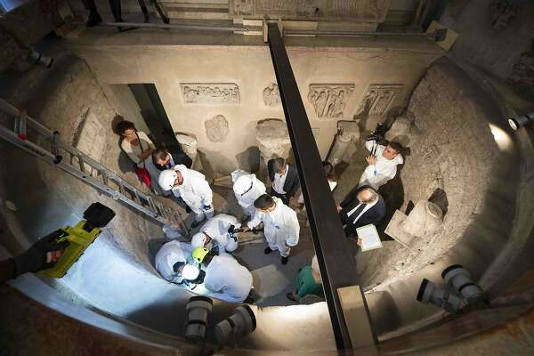 TOPSHOT - This handout photo made available by the Vatican Media on July 20, 2019 shows the opening of the ossuary at the Teutonic Cemetery in the Vatican as part of a probe into the case of Emanuela Orlandi, an teenager who disappeared in 1983 in one of Italy's darkest mysteries. - The Vatican opened two burial chambers discovered under a trapdoor as it attempts to get to the bottom of a riddle involving two 19th century princesses and a teenager who went missing 36 years ago. The ossuaries were found last week under the floor of the Pontifical Teutonic College after the shock discovery earlier this month that the bones of the princesses had disappeared from two tombs in the Teutonic Cemetery. (Photo by Handout / VATICAN MEDIA / AFP)HANDOUT/AFP/Getty Images
