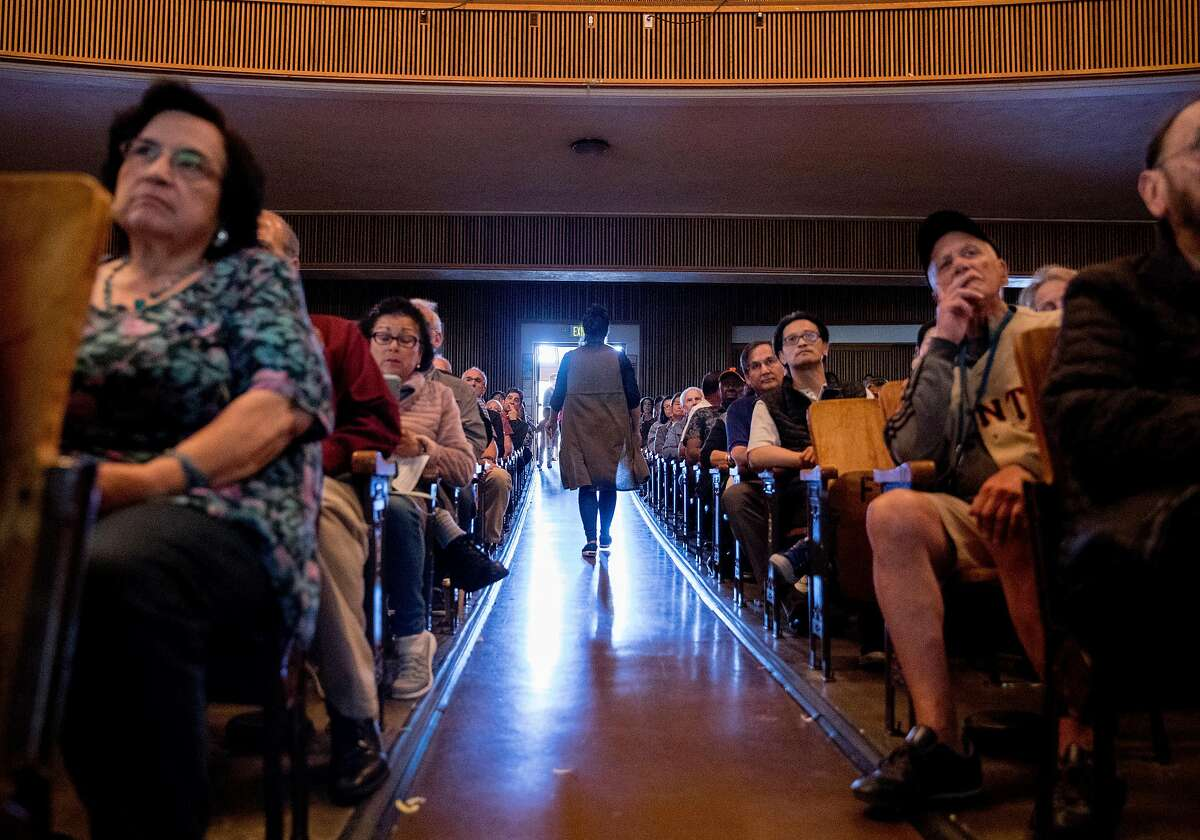 Neighbors and residents gather in the auditorium of Balboa High School to attend a community meeting held at Balboa High School in San Francisco, Calif. Saturday, July 20, 2019 addressing the proposed safe parking center near the Balboa BART Station for people who are homeless and live in their cars.