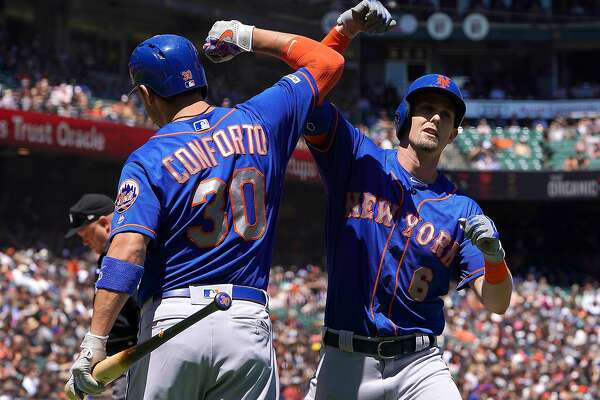 SAN FRANCISCO, CA - JULY 20: Jeff McNeil #6 of the New York Mets is congratulated by Michael Conforto #30 after McNeil hit a two-run home run against the San Francisco Giants in the top of the fifth inning at Oracle Park on July 20, 2019 in San Francisco, California. (Photo by Thearon W. Henderson/Getty Images)