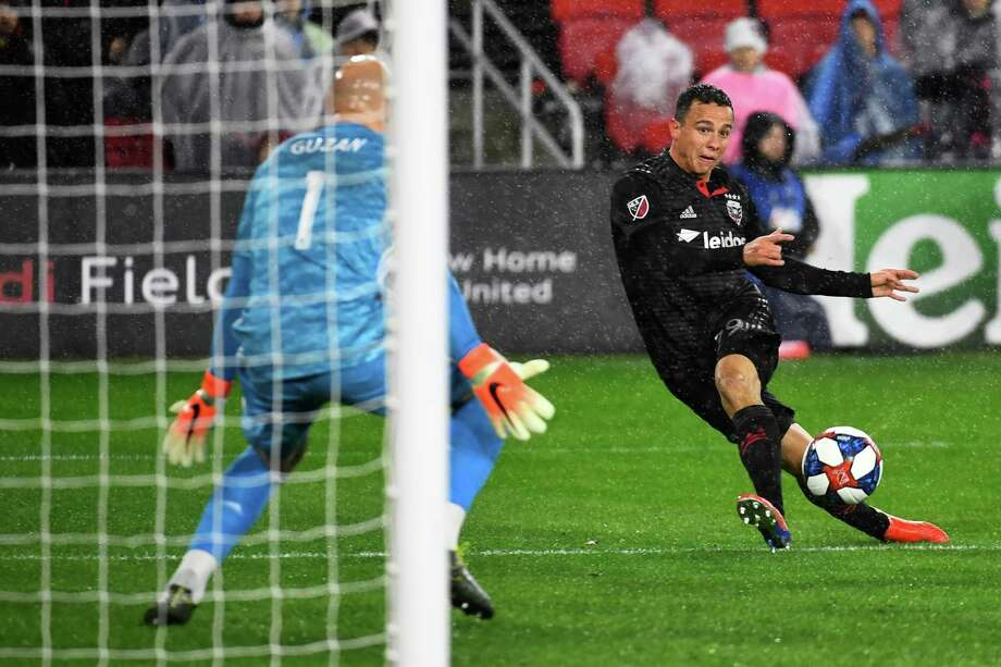 Leonardo Jara takes aim against Atlanta's Brad Guzan in the first meeting of the season, in March at Audi Field. The teams will clash again Sunday at Mercedes-Benz Stadium. Photo: Washington Post Photo By Katherine Frey / The Washington Post