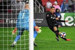 Leonardo Jara takes aim against Atlanta's Brad Guzan in the first meeting of the season, in March at Audi Field. The teams will clash again Sunday at Mercedes-Benz Stadium.