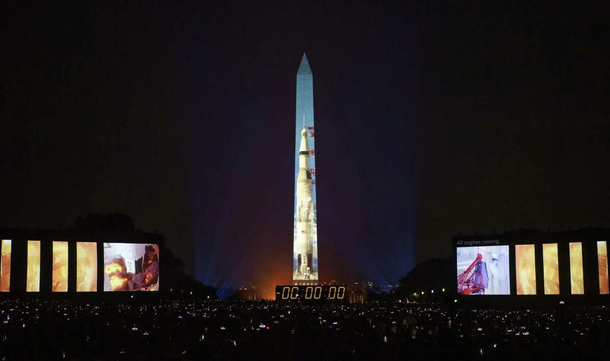 The 50 year anniversary of the Apollo 11 mission with NASA astronauts Neil Armstrong, Michael Collins, and Buzz Aldrin is celebrated in a 17-minute show, Apollo 50: Go for the Moon which combined full-motion projection-mapping artwork on the Washington Monument and archival footage to recreate the launch of Apollo 11 and tell the story of the first moon landing, Friday, July 19, 2019 in Washington.
