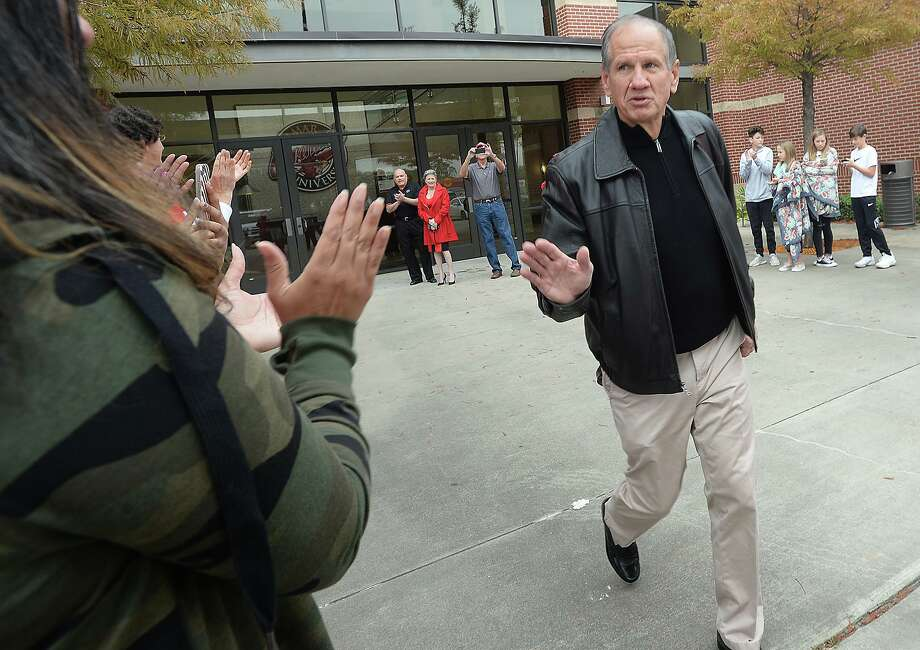 Coach Mike Schultz waves to the line of fans who formed a tunnel, clapping as Lamar players and coaches make their way out of the Dauphin Athletic Complex to board their buses and set out for Northern Iowa, where they will play in their first FCS play-off game Saturday.  Photo taken Friday, November 23, 2018  Kim Brent/The Enterprise Photo: Kim Brent / The Enterprise / BEN
