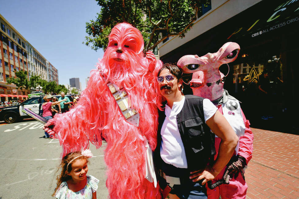 Cosplayers attend the 2019 Comic-Con International on July 20, 2019 in San Diego, California.