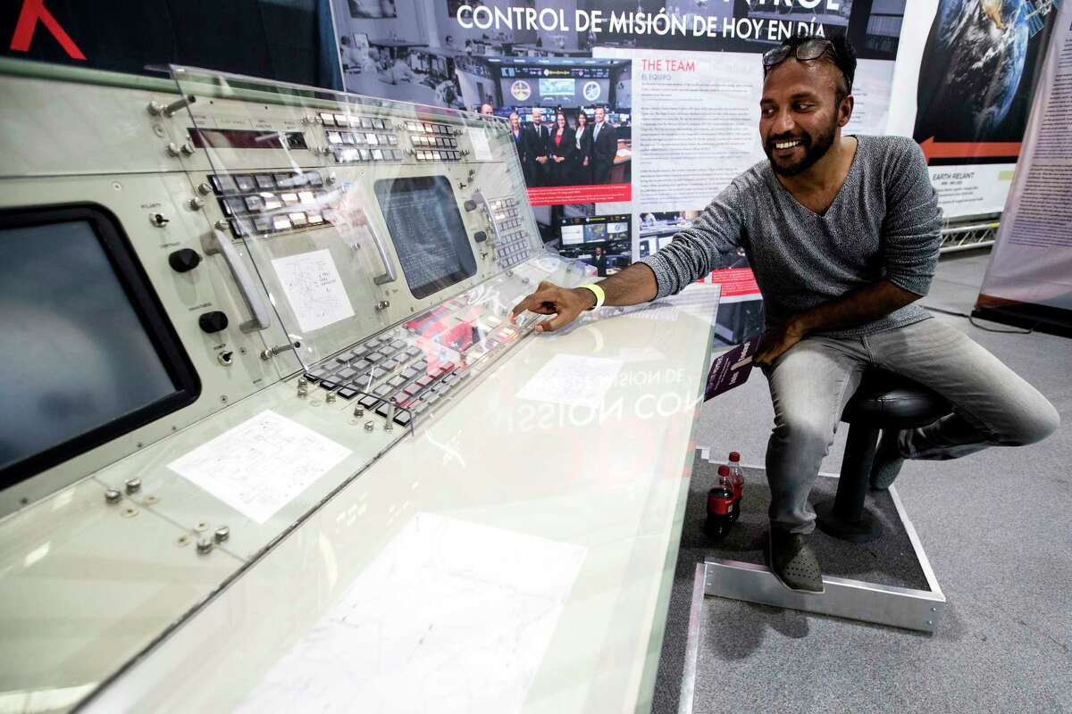 Abhilash Peddu, of India, sits down at a mission control work station on display at Rocket Park during the 50th anniversary celebration of the Apollo 11 moon landing at Space Center Houston on Saturday, July 20, 2019, in Houston. Peddu came to Houston from India specifically to attend the Apollo 11 50th anniversary celebration.