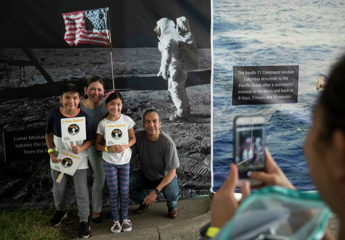 Manuel Perez, from left, Sandra Lobato, Andrea Perez and Ricardo Perez, from Mexico City pose for a photo in front of a photo of Buzz Aldrin as they arrive to the 50th anniversary celebration of the Apollo 11 moon landing at Space Center Houston on Saturday, July 20, 2019, in Houston. The family came to Houston from Mexico for the Apollo celebration.