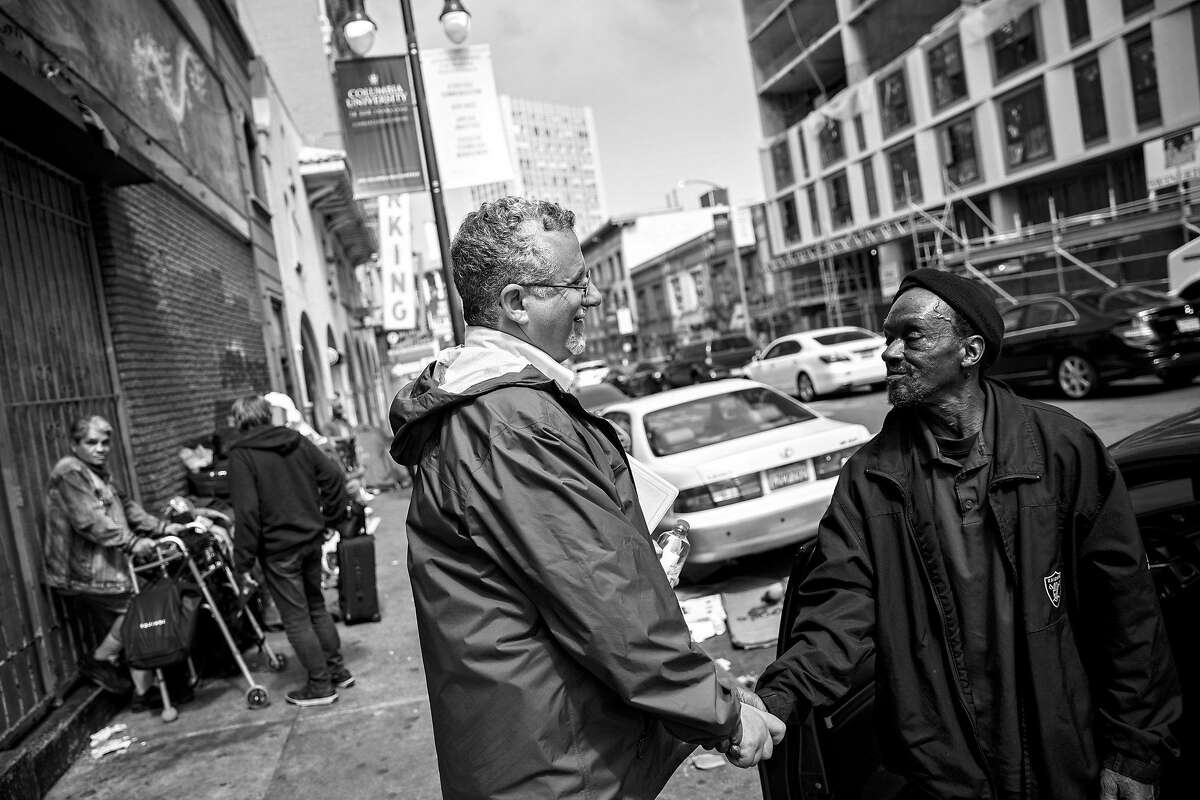 Jeff Kositsky, director of San Francisco Department of Homelessness and Supportive Housing, left, greets John Earl whom Kositsky assisted while checking on the Homeless Outreach Team (HOT) Tenderloin Operation in San Francisco on Tuesday, June 18, 2019.