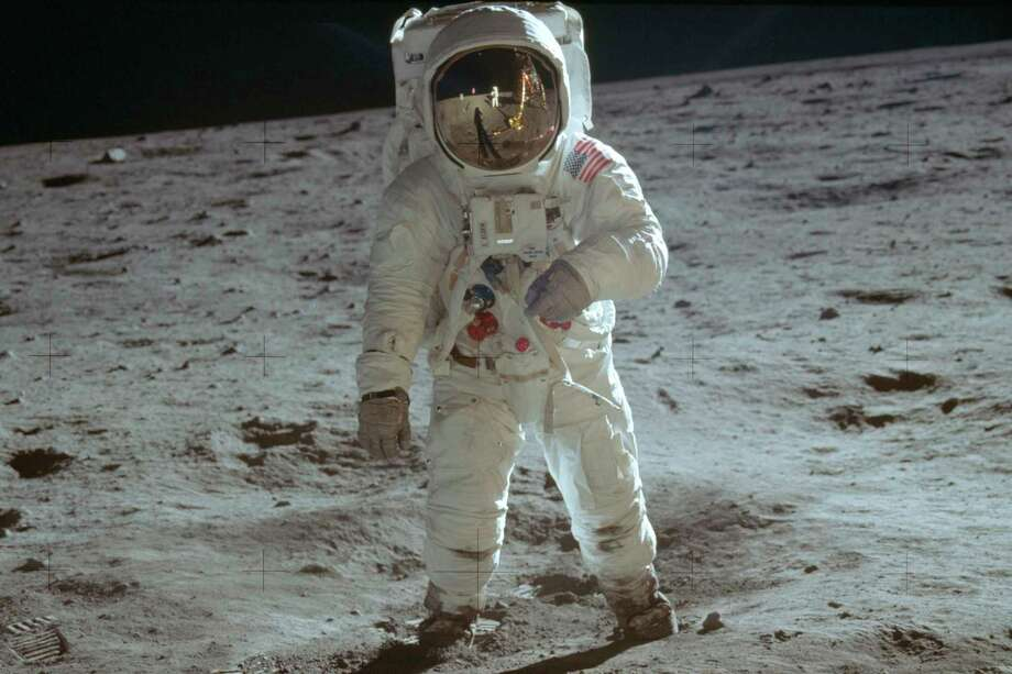 In this July 20, 1969 photo made available by NASA, astronaut Buzz Aldrin, lunar module pilot, walks on the surface of the moon during the Apollo 11 extravehicular activity. (Neil Armstrong/NASA via AP) Photo: Neil Armstrong / NASA