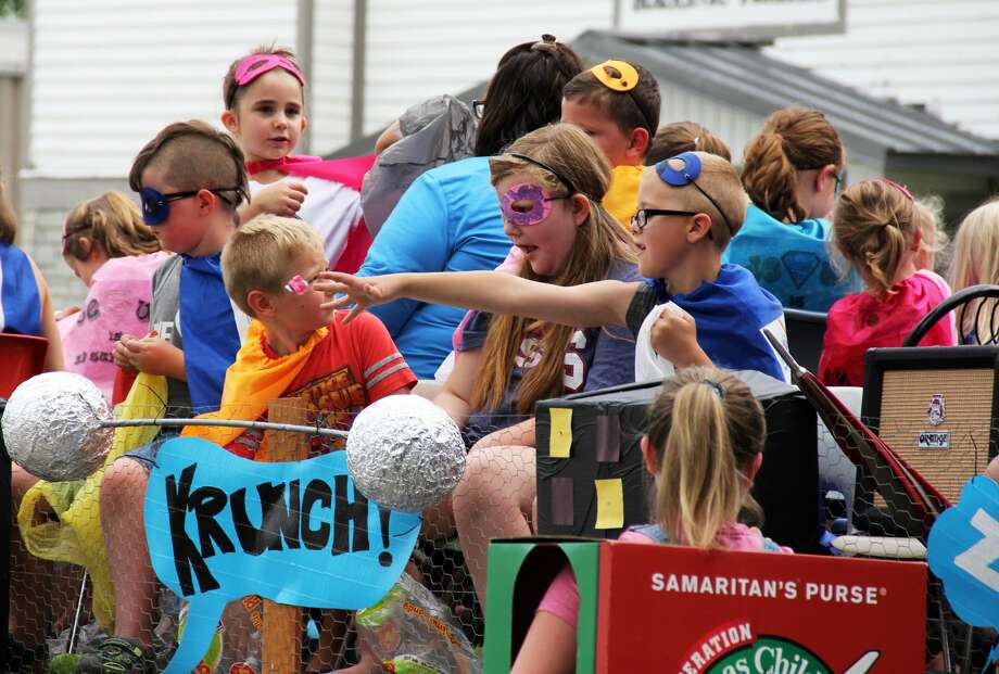 A parade rides its way through downtown Pigeon during the 2019 Pigeon Farmer's Summerfest. There were kids activities and meals after the parade finished. Photo: Andrew Mullin/Huron Daily Tribune