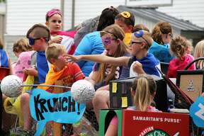 A parade rides its way through downtown Pigeon during the 2019 Pigeon Farmer's Summerfest. There were kids activities and meals after the parade finished.