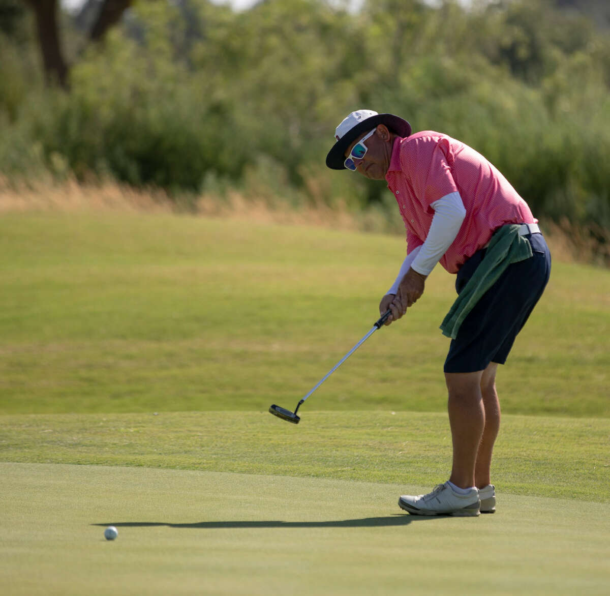 Rick Houston putts on the seventh green Saturday, July 20, 2019 during the West Texas Amateur golf tournament second round at Midland Country Club.Jacy Lewis/Reporter-Telegram