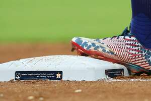 The bases were dedicated to Apollo 11 during the MLB baseball game at Minute Maid Park Saturday, July 20, 2019, in Houston.