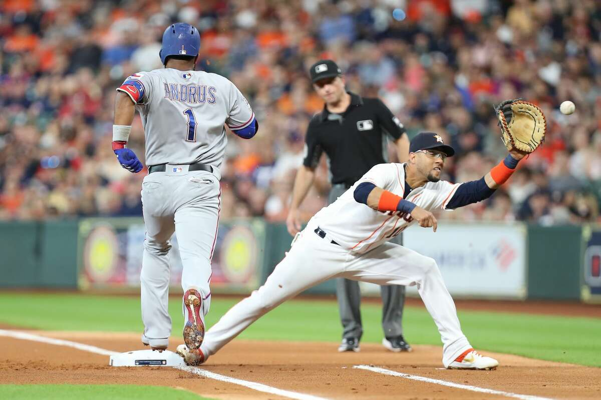 Texas Rangers shortstop Elvis Andrus (1) is thrown out by Houston Astros catcher Robinson Chirinos (28) as Houston Astros first baseman Yuli Gurriel (10) makes the catch during the first inning of an MLB baseball game at Minute Maid Park Saturday, July 20, 2019, in Houston.