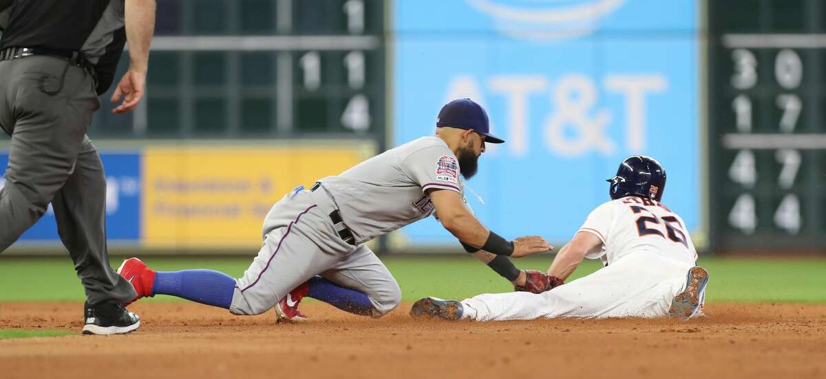 Houston Astros center fielder Myles Straw (26) steals second as Texas Rangers catcher Jeff Mathis (2) applies the tag during the sixth inning of an MLB baseball game at Minute Maid Park Saturday, July 20, 2019, in Houston.