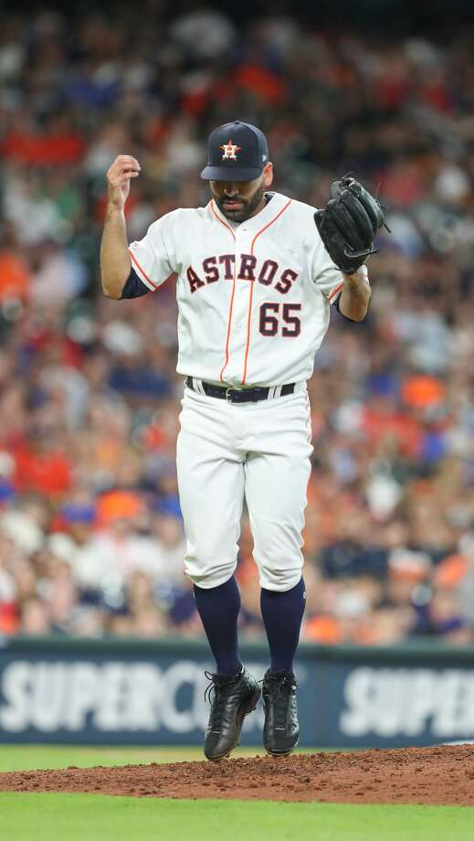 Houston Astros Jose Urquidy jumps into the air after closing out the fifth inning of an MLB baseball game at Minute Maid Park Saturday, July 20, 2019, in Houston. Photo: Steve Gonzales/Staff Photographer