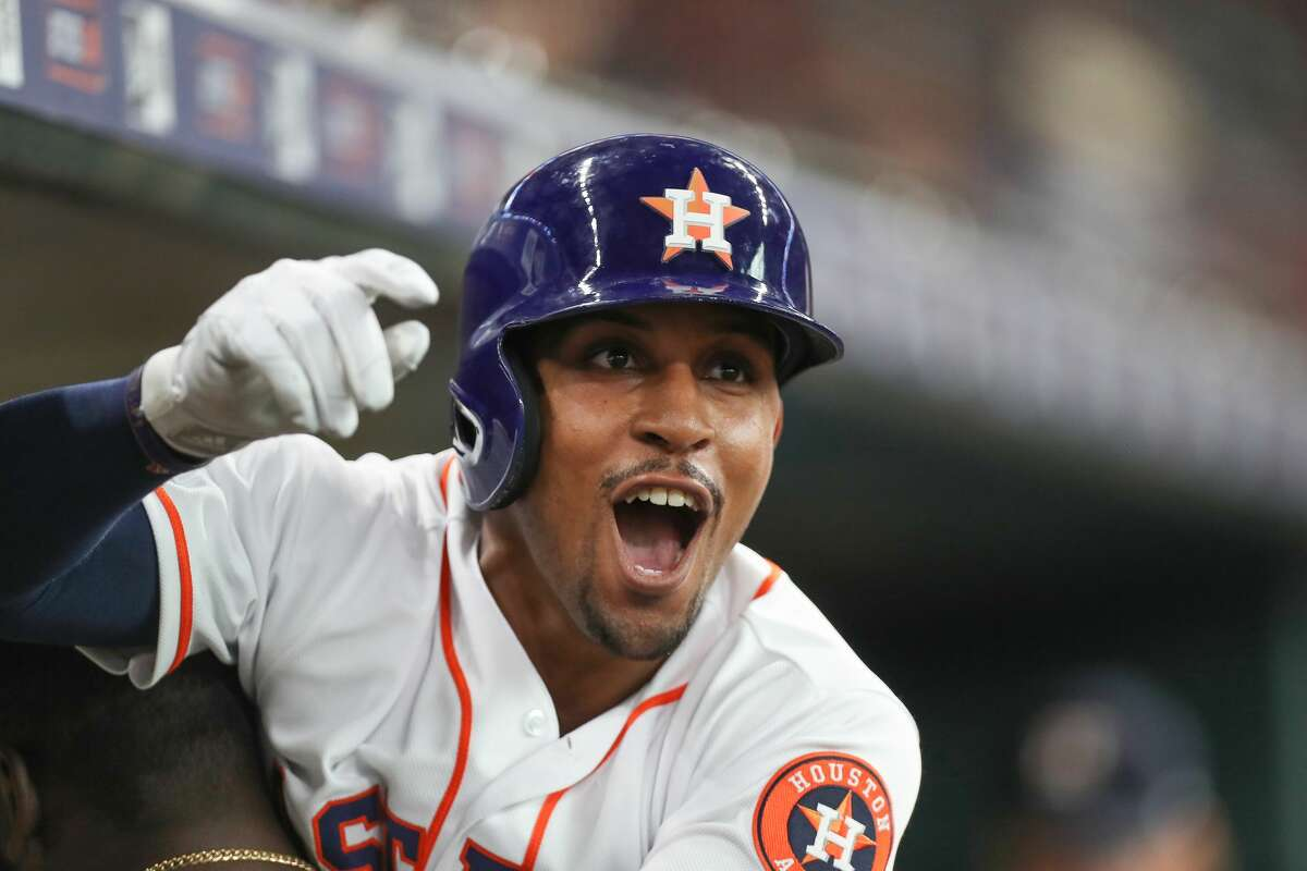 Houston Astros left fielder Tony Kemp (18) celebrates after hitting a homer during the sixth inning of an MLB baseball game at Minute Maid Park Saturday, July 20, 2019, in Houston.