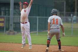 Darren Dyson easily steals second base during fifth-inning action Saturday. Moments later, he scored NASA-Orange's final run on Texas soil. Next stop, the Pony 13s World Series in California.