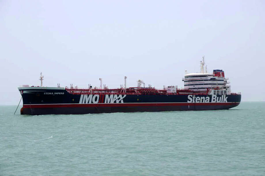 "A British-flagged oil tanker Stena Impero which was seized by the Iran's Revolutionary Guard on Friday is photographed in the Iranian port of Bandar Abbas, Saturday, July 20, 2019. The chairman of Britain's House of Commons Foreign Affairs Committee says military action to free the oil tanker seized by Iran would not be a good choice. Tom Tugendhat said Saturday it would be ""extremely unwise"" to seek a military solution to the escalating crisis, especially because the vessel has apparently been taken to a well-protected port. (Tasnim News Agency/via AP) / Tasnim News Agency"