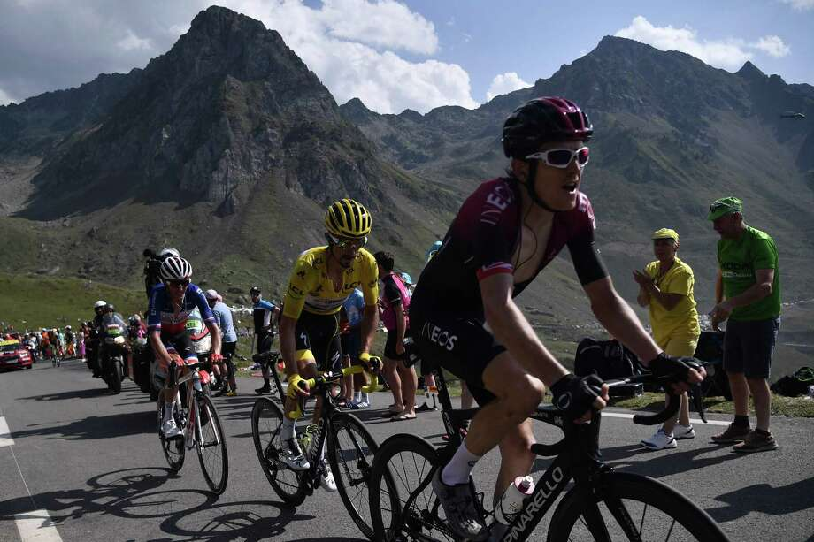France's Julian Alaphilippe (C), wearing the overall leader's yellow jersey, Great Britain's Geraint Thomas (R) and cyclists of the front of the race ride together in the last kilometers during the fourteenth stage of the 106th edition of the Tour de France cycling race between Tarbes and Tourmalet Bareges, on July 20, 2019. (Photo by Marco Bertorello / AFP)MARCO BERTORELLO/AFP/Getty Images Photo: MARCO BERTORELLO / AFP or licensors